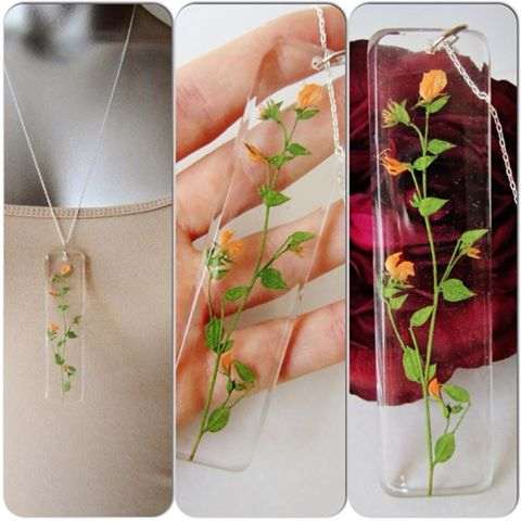 Beautiful new resin work jewelry making outside the box oksana dries and carefully arranges botannicals wild flowers sprigs and the like in clear layers of resin to make lovely pendants aloadofball Images